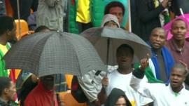 Crowd dancing under umbrellas