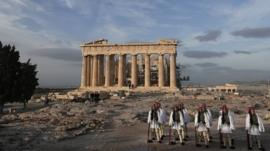 Greek Presidential Guards at Parthenon temple at the Acropolis hill in Athens