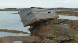 Damaged bird hide at Snettisham