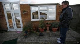 Steve Connelly looks at the remains of his home