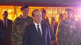 The President of France, Francois Hollande, inspecting coffins of French soldiers