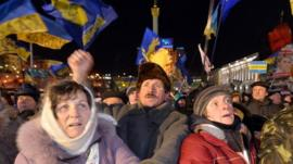 Protesters wave Ukrainian flags during an opposition rally on Independence Square in Kiev