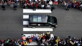 The body of former South African president Nelson Mandela is transported to the Union Buildings on December 11