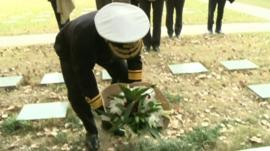 Rear Admiral Matthew Parr laying a tribute at the graves