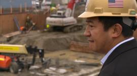 Lobsang overlooks a construction site