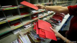 Christmas post being sorted at a Royal Mail sorting office