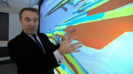 BBC reporter John Moylan beside a 3D visual representation of the geology of the UK