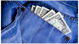 $100 bills protruding from back pocket