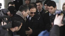 Baris Guler (C in sunglasses), son of Turkey's Interior Minister Muammer Guler