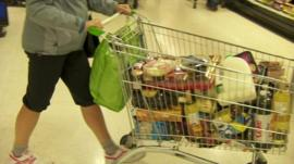 Shopper with full trolley