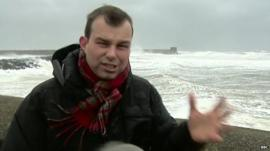 BBC reporter James Cook buffeted by the winds in Ayrshire, Scotland
