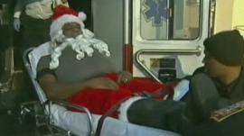 Man dressed as Santa carried into ambulance