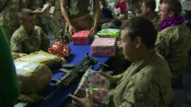 Armed forces personnel with presents and decorations in Camp Bastion