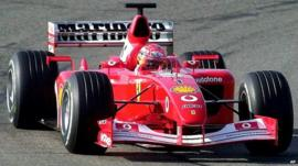 Michael Schumacher steers a Ferrari in 2002
