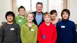 Michael Palin and children at the centre