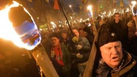 Nationalists hold torches during a march in Kiev