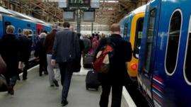 Rail commuters in King's Cross station