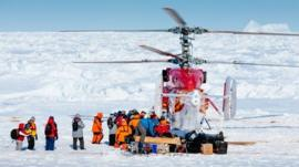 A Chinese helicopter airlifting passengers