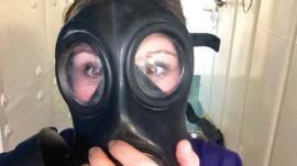 Anna Holligan tries on a gas mask