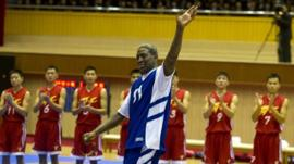 Dennis Rodman waves to the crowd