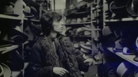 Bill Wyman, former guitarist for the Rolling Stones in a hat shop