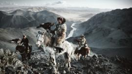 Kazakh eagle hunters on horseback