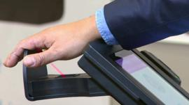 A palm being scanned by the Pulse Wallet