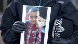 Superintendent Liz McAinsh holds a photo of missing child Mikaeel Kular