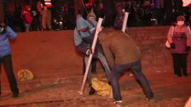 Protesters breaking up pavement