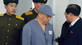 Kenneth Bae arrives for a 'press conference' in Pyongyang on 20 January 2014