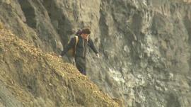 Man near cliffs in Dorset