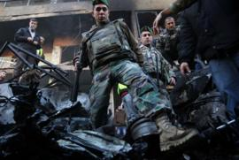 Lebanese soldiers inspect Beirut bomb aftermath