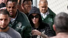 Justin Bieber (centre) exited the Turner Guilford Knight Correctional Center in Miami, Florida, on 23 January 2014