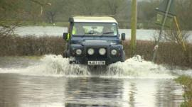 Vehicle in floodwater