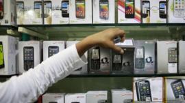 Mobile phones on a shop shelf