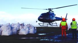 Helicopter flying stones to Offa's Dyke