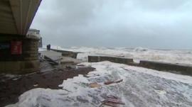 Debris washed up on sea front in Dawlish