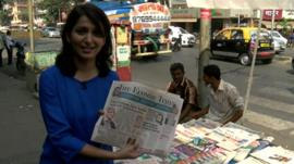 Yogita Limaye holds newspaper