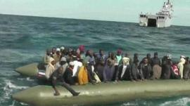 Migrants on boat in Mediterranean