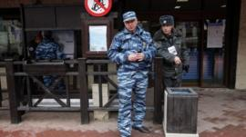 Russian police officers guard an entrance of a cableway in Krasnaya Polyana, mountain Olympic cluster