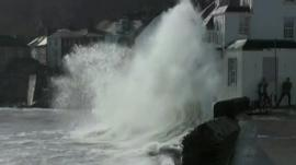 Wave crashing against building