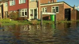 The street sign and flood water