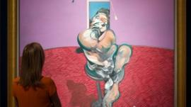 A woman looks the painting by Francis Bacon