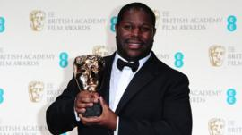 Steve McQueen celebrates winning the Best Film Bafta for the film 12 Years A Slave