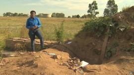 BBC reporter, Nomsa Maseko, at entrance to mine in Benoni