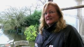 Egham resident Angela Cooper and her flooded garden