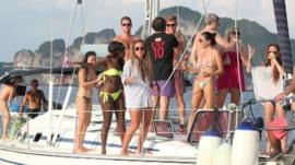 Expats having fun on a boat