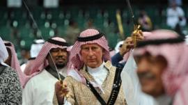 Prince Charles performs traditional Saudi sword dance