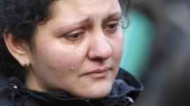 A woman cries during a funeral procession for one of the dead during violence in central Independence Square in Kiev