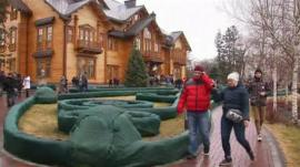 People walking around the grounds of Mr Yanukovych's house